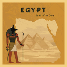The Ancient Egyptian God Anubis Painted Against The Background Of The Map Of Egypt With Pyramids.