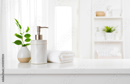 Fototapeta Soap dispenser and spa towel on pastel bathroom window interior obraz