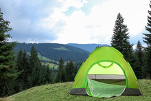 Green Camping Tent Near Beauti...