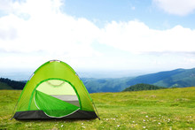 Green Camping Tent In Mountain...