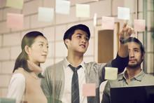 Young Asian Business Men Entre...