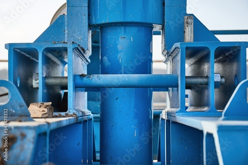 Industrial metal structures at a dam, steel metal beams, axles fixed by cotter p Canvas Print
