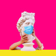 Leinwanddruck Bild - Gypsum statue of Apollo head in crown. Creative. Plaster statue    of Apollo head in medical mask. Woman hands  . On a pink background. Concept art collage.