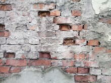 Old Red Brick Wall With Remnants Of Cement Mortar