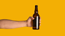 Male Hand Holding Bottle Of Re...