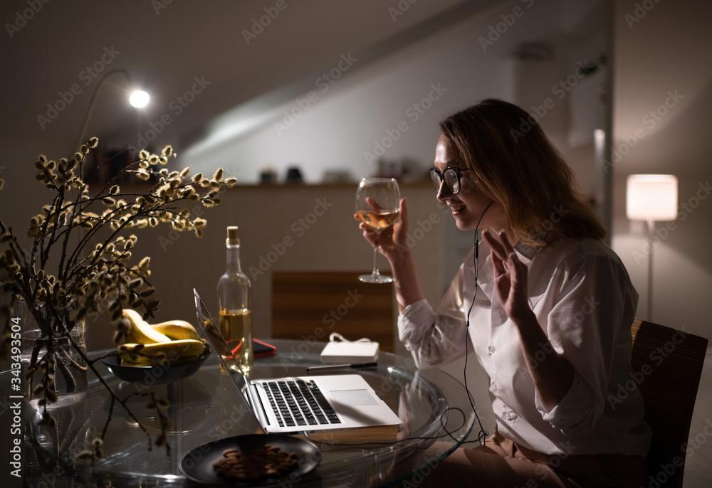 Fototapeta Young woman enjoying video call at home