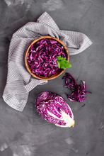 Red Cabbage - Cut Head And Sliced - On Grey Kitchen Table Top View