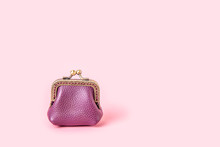 Purple Leather Wallet, Coin Holder With Metal Hardware On A Pink Background.