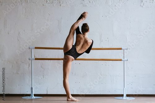 Beautiful ballerina training in the class Fototapete