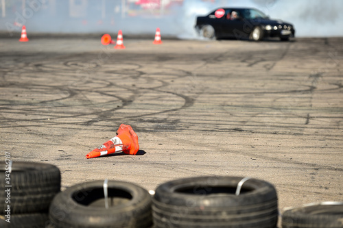 Valokuva Rubber drift traces and traffic cones inside a driving school polygon