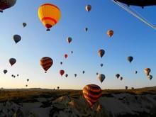 Hot Air Balloons Over Cappadocia Against Sky