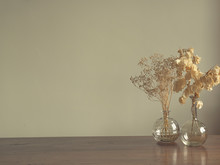 Two Vases With Dried Flowers