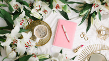 Female Pink Notebook Lies On W...