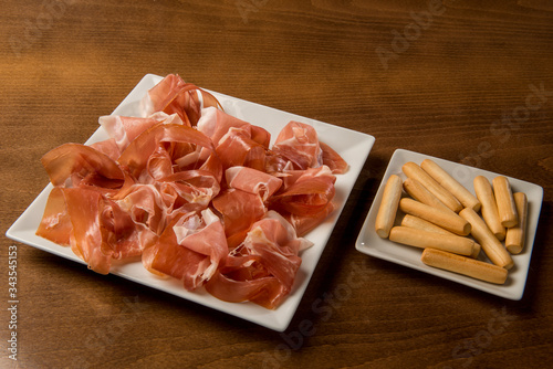 Fotografia, Obraz typical spanish food plate of iberian ham with croutons