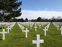 Crosses At Normandy American Cemetery And Memorial Against Sky