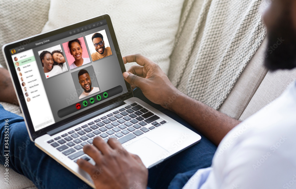 Fototapeta Lockdown communication. African American man having video conference with his family at home, collage