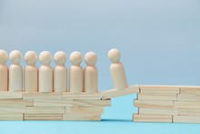 Human Ambition. Challenge Accepted. Original Vision. Wooden Figures On Stack Of Planks. Person Crossing Over Bridge