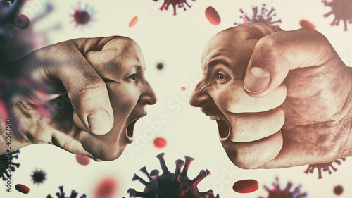 Photo Two fists with man's and woman's face are collide with each other on coronavirus background