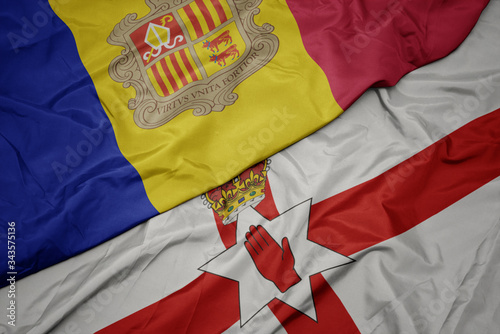 waving colorful flag of northern ireland and national flag of andorra Wallpaper Mural