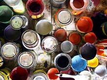 Directly Above Shot Of Colorful Paint Cans On Floor