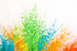 Colorful powder explosion. Abstract bright color dust particles