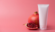 Antioxidant Bath Advert Lifestyle Pampering Concept. Panoramic Photo Of Jar Container Of Stylish Package Creme With Nutritional Minerals Red Pomegranate Aroma Isolated Pastel Color Background