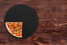 A Quarter Of Pizza With Mushrooms, Corn, Cherry Tomatos, Courgettes And Bell Peppers On A Slate Round Plate On The Brown Wooden Background, Top View