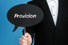 Provision. Businessman In Suit Holds Speech Bubble At Camera. The Term Provision Is In The Sign. Symbol For Business, Finance, Statistics, Analysis, Economy