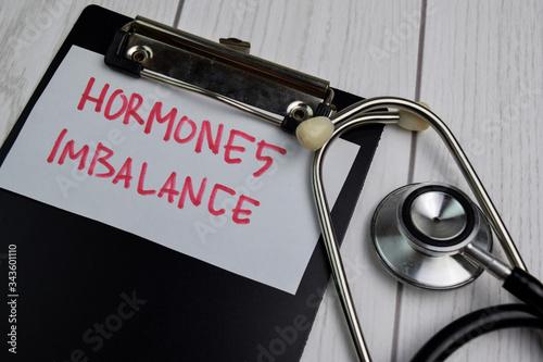 Valokuvatapetti Hormones Imbalance write on sticky notes isolated on office desk