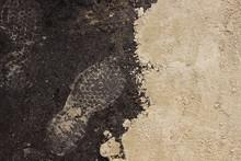Footprints On The Ground. Sand...