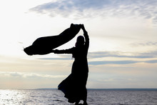 Silhouette Of A Muslim Girl On...