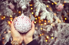 Human Hand Holding Christmas Bauble