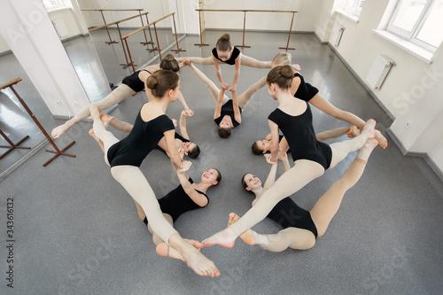 Young ballerinas rehearse a choreographic exercise at a ballet school