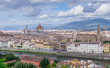 Aerial view of the city of Florence, Italy, with the Cathedral of Santa Maria di Fiori and the Basilica of Santa Croce in the background