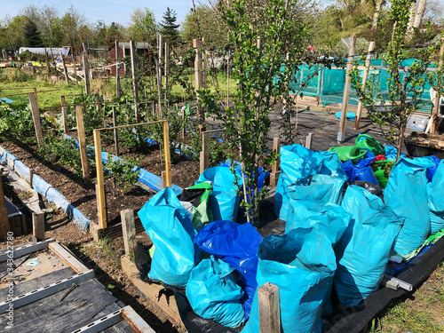 Photo Landscape of allotment beds in English organic vegetable garden with bads of org