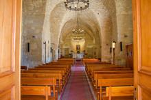 Empty Pews In Church Seen Through Entrance