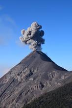 Smoke Column From The Chimney Of Acatenango Volcano. Volcan Del Fuego Erupting Big Black Smokes In Guatemala