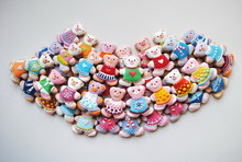 Directly Above Shot Of Colorful Teddy Bear Shape Christmas Cookies On White Background