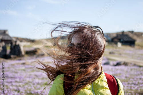 Fototapeta young beautiful woman walking outside windy day