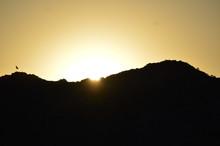 Sun Peeking Through Mountains