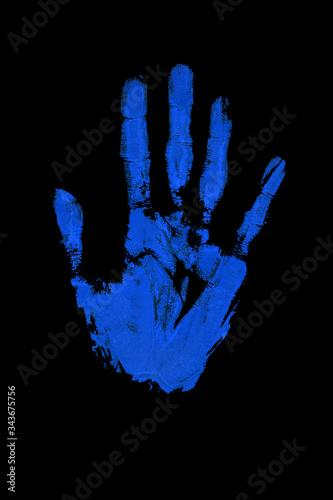 Valokuva Blue human hand print on black background isolated close up, handprint illustrat