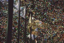 Low Angle View Of Flags By Illuminated Christmas Decorations On Rockefeller Center At Night