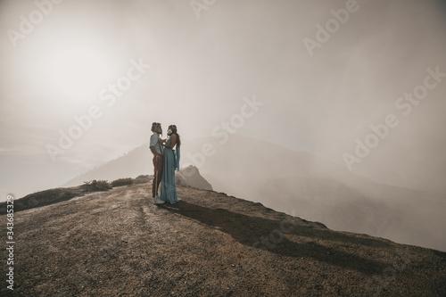 Couple in protective masks hug Fototapet