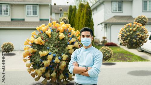 Fotografija Asian Man Wearing Mask Standing on Street Invaded by 3D Coronavirus Molecules -