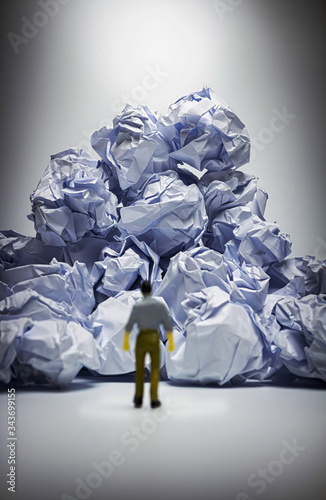 Vászonkép The mna Facing with problem and obstacle,crumpled paper  heap with man Figure