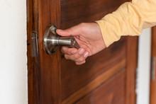 Men's Hand Opens Wooden Door H...