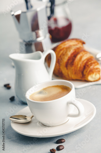 Fototapety, obrazy: Coffee espresso in white cup with milk, jam and croissants.