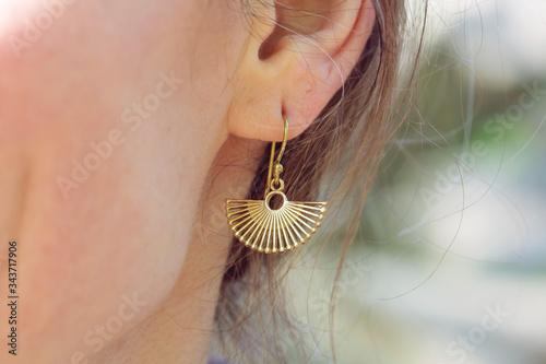 Obraz na plátně Outdoor detail of female ear wearing beautiful elegant earring