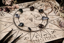 Drawing With Magic Spells, Minerals And Black Candles On Witch Table.