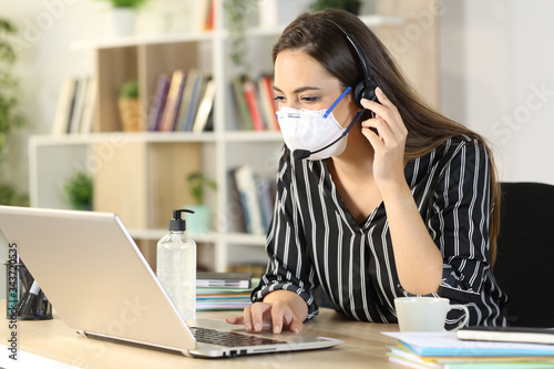 Obraz Telemarketer with laptop working at home due covid-19 - fototapety do salonu